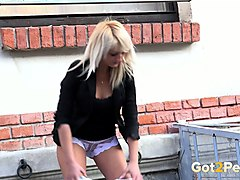 blonde babe with long legs loves pissing in public places