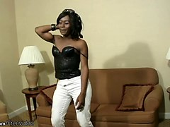 ebony tgirl in black lingerie wraps mouth around white cock