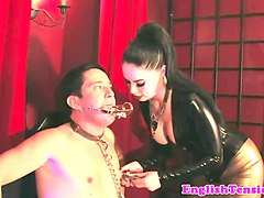 latex mistress worshipped by caged slave