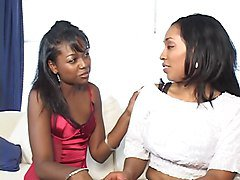 Lesbian ebony chick with big natural tits gets fingered by a black babe
