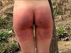 tied to a tree and severely spanked