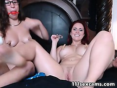 two lesbian camgirl play with toys on webcam
