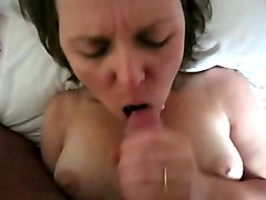 she sucks and jerks off my dick and i cum on her beautiful face