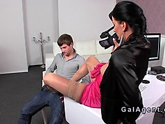 female agent gives footjob in stockings