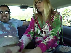 blonde gives a tugjob in the backseat