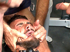 Horny gym goers dump their loads on a muscled gym rat