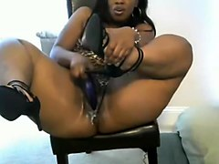 Juicy black woman shoves dildo in pussy!