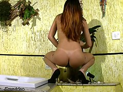 redhead tattooed chick with dick is pumping her tranny dick